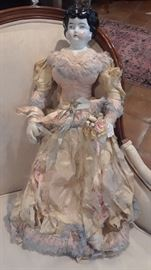 Large china doll in original silk dress. Handle with care.