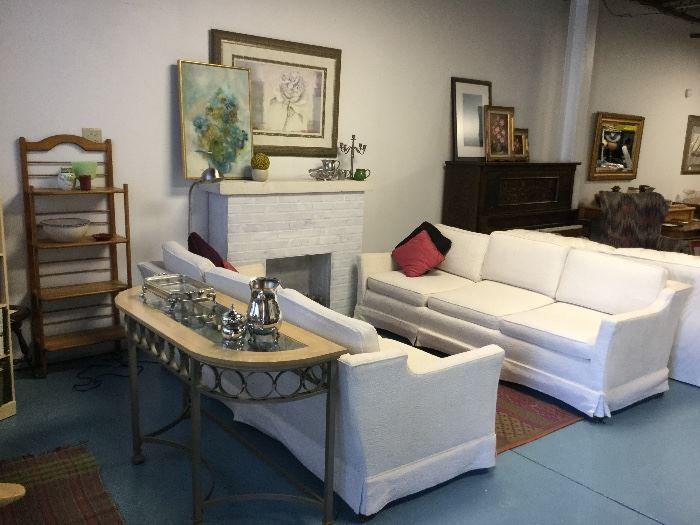 Henredon winter-white sofas. Contemporary glass top sofa table.
