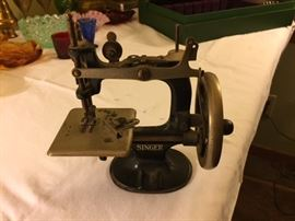 Small Singer Sewing Machine.