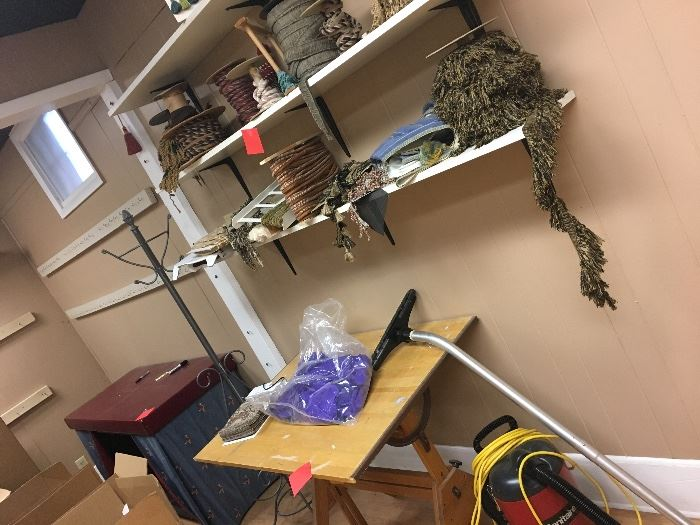 Trips, tassels, tables, hat rack, drafting table