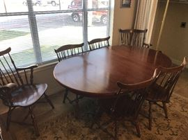 Cherry dining table w/6 chairs and two leafs $375