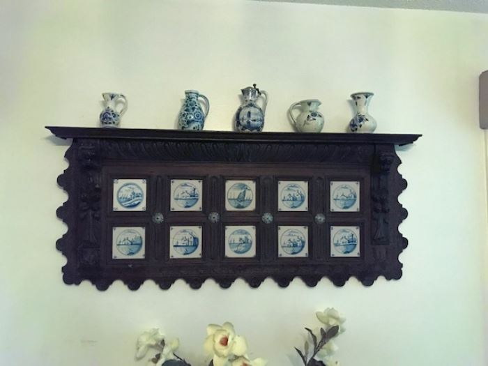 Dutch wood carved shelve with ten Delft tiles. a rare large piece. 19th century.