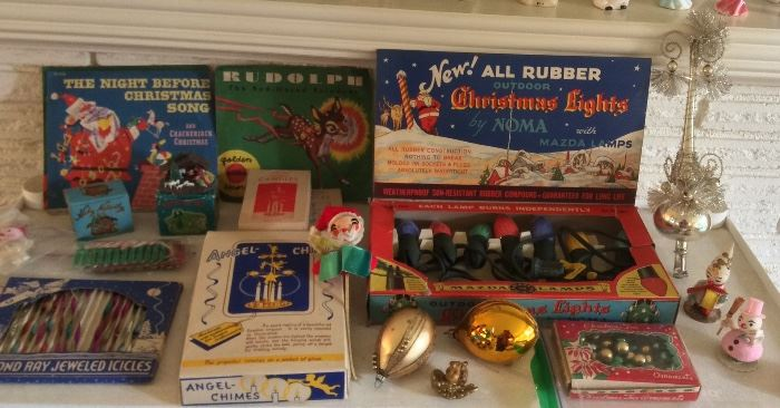 Vintage Xmas items: Little Golden kids records, metal icicles in original box, angel chimes, Noma Mazda Xmas light set in box, German mercury glass tree topper