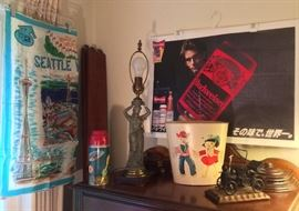 Eclectic goodies: 1962 Seattle Worlds Fair scarf, vintage space theme Thermos, goddess lamp, adorable waste basket, 1992 Huey Lewis/Budweiser Japan tour poster, metal jalopy sculpture