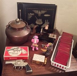 More vintage goodies: Japanese copper teapot, Hubley Trooper toy cap gun with box, Zell compact/coin purse combo, funny yarn animals, German toy sewing machine, military theme scrapbook (empty), Little Leather Library books (red cover)