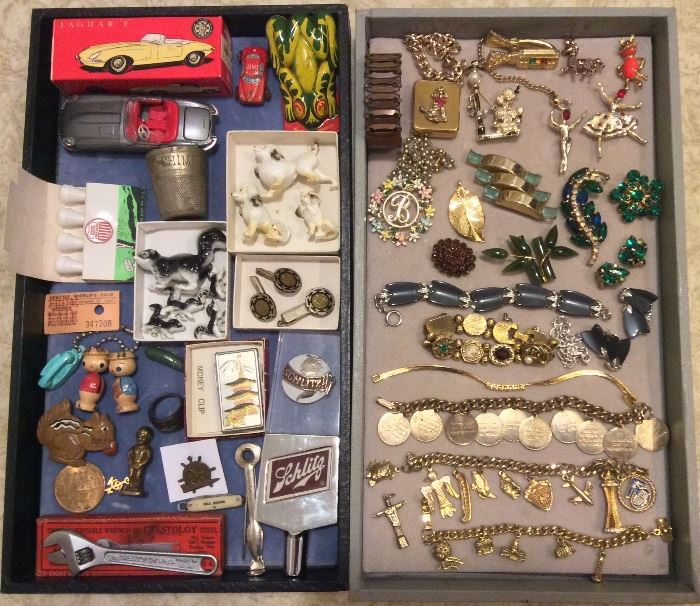 Small collectibles incl. Tekno Jaguar E (toy car) with box, mini animal figurines, Mexican cufflink set, Schlitz beer tap. Costume jewelry: musical poodle bracelet, vintage animal pins, rhinestone brooches, old garnet brooch, braceles including charm bracelets (10 Commandments & NW theme)