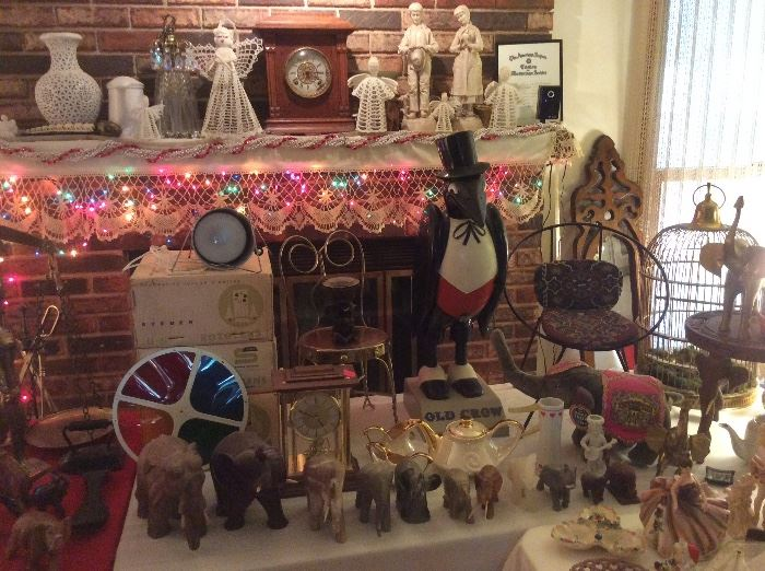 Orginal color wheels. The old crow is missing his glasses and umbrella.  Nice old clock. Elephant collection.