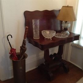 Empire card table circa 1840; oil lamp electrified; cut glass footed bowl; lead vase; umbrella stand