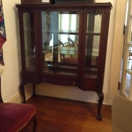china cabinet that matches buffet and sideboard; mirrored back and glass shelves.  Ball and claw kneed leg and foot