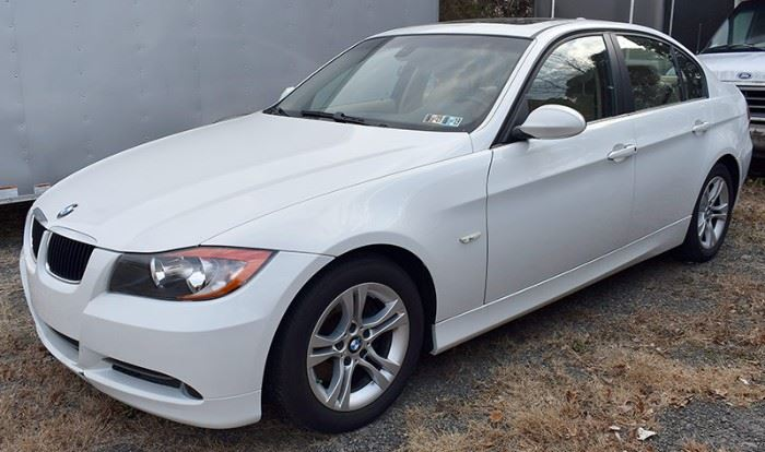 8PM: 2008 BMW 328i Estate Auto with 23,471 Miles; White Exterior, Tan Leather Interior; Power Everything; Power Moonroof; AM/FM Stereo with CD; Heated Seats; Dual Climate Controls, and more. VIN: WBAVC57578NK78014.
