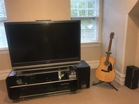 Sony TV $150,  Onkyo receiver/speakers- theatre system $150,  Entertainment stand $175,  Fender guitar with stand $200