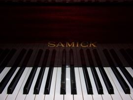 Samick Baby Grand Piano with Mahagony High Polish Finish... Beautiful!! OUR PRICE $2,000(new $6,000) Mover available for nominal fee!  Samick SIG 50 Posted Under: Samick Pianos - Grands 4′ 11 1/2″ Traditional Grand Height: 3′ 4.5″ Width: 5′ Weight: 701 lbs. Soundboard Area: 1555 sq. in. #1 Bass string: 42 7/8″ SPECIFICATIONS: SOUNDBOARD: all spruce surface tension PIN BLOCK: 16-ply laminated maple TUNING PINS: nickel plated STRINGS: made of Roslau music wire AGRAFFES: 50 or more agraffes in the bass section HAMMERS: double coated premium grade wool KEYS: full-length, balanced and weighted ACTION: all maple with aluminum rail BRIDGES: maple with an extended cantilever bass bridge RIBS: spruce and notched into the inner rim PLATE: pure iron ore made in the traditional method of slow sand casting BEAMS: laminated hardwood MIDDLE PEDAL: full sostenuto