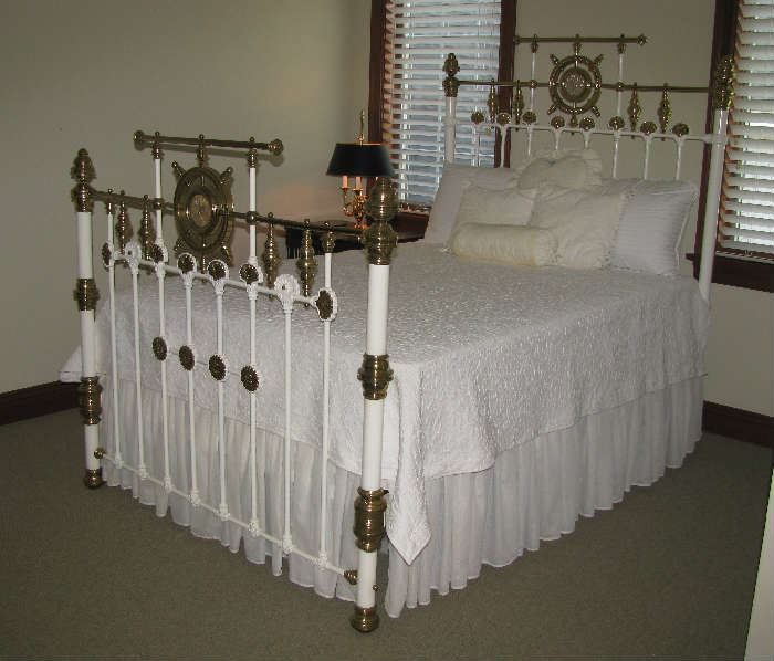 Iron and brass bed with mother of pearl medallions.