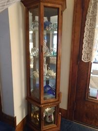 Lighted curio cabinet, glass collection