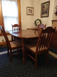 Dining room table with a leaf and 4 chairs