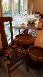 Variety of old chairs, pottery