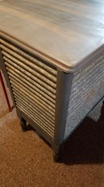 Side and back of upcycled kitchen island with reclaimed galvanized metal.