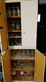 Vintage canning jars and stacking vintage cabinets
