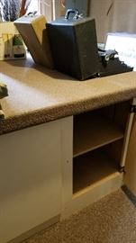 Large work table with storage. Carpeted top lifts off for moving. Two available.