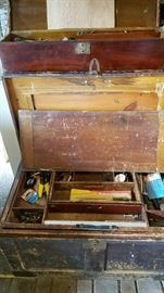 Beautiful old trunk. Top trunk in picture stores inside. Filled with tools