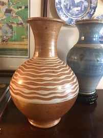 Vintage handmade brown pottery vase.