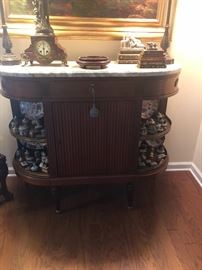 "Marble top sideboard with open side shelves. 49.5"" long x 18"" wide"