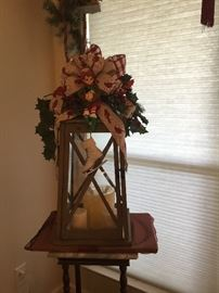 Lantern with handmade floral decorations.