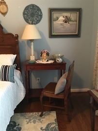 Desk with drawer and bottom shelf.  Has antique oak chair with leather fabric.