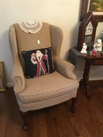 Beautiful wing back chair in beige fabric.