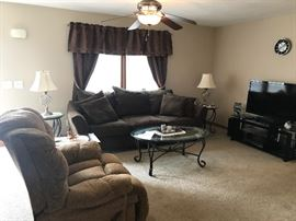 Microfiber brown sofa, Glass top end tables & coffee table, Tv & surround sound