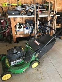 John Deere mower, many tools