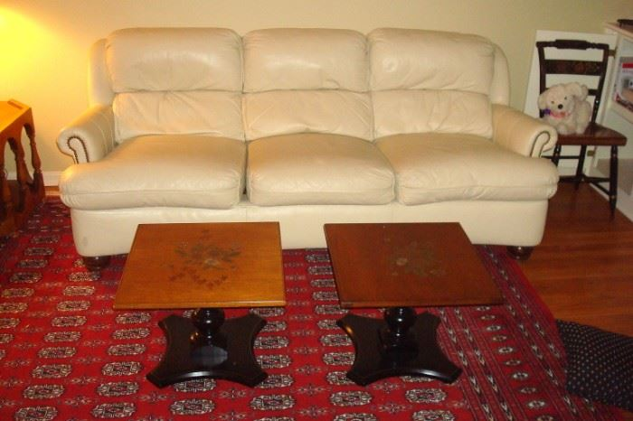 White leather sofa, pair Hitchcock end tables and partial view room size Bokara Persian rug.
