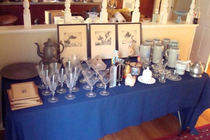 Table of collectibles including early pewter items.