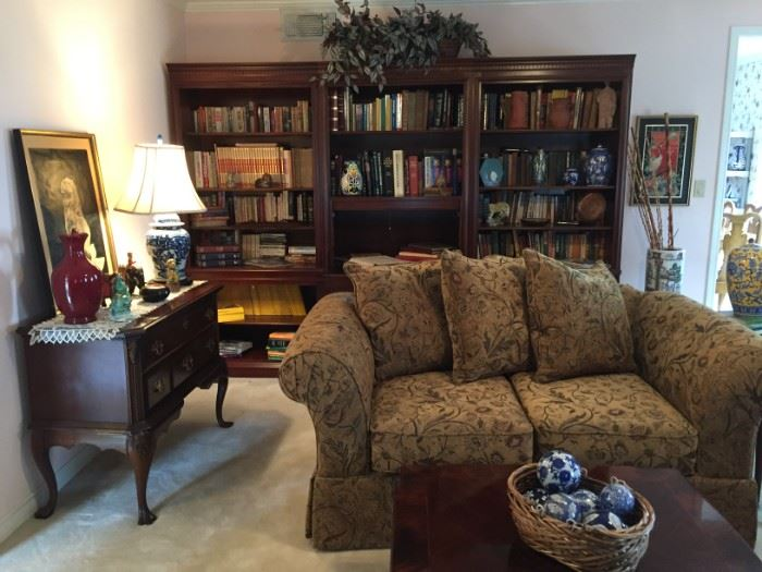 Bookcases, writing desk, buffet, sofa, square coffee table