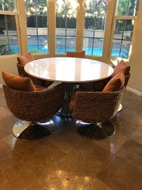 Palecek Chairs and Stone table - $4,000