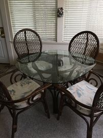Beautiful glass table top with 4 chairs includes cushions