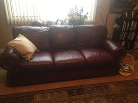 Leather sofa$600 ,leather $600 and two side chairs $150ea.   Burgundy wine color All sold separately