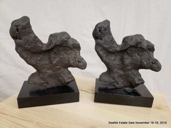 Unusual fossil-look sculpture on plinth.