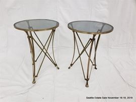 Bronze and glass side table with lion's paw feet.