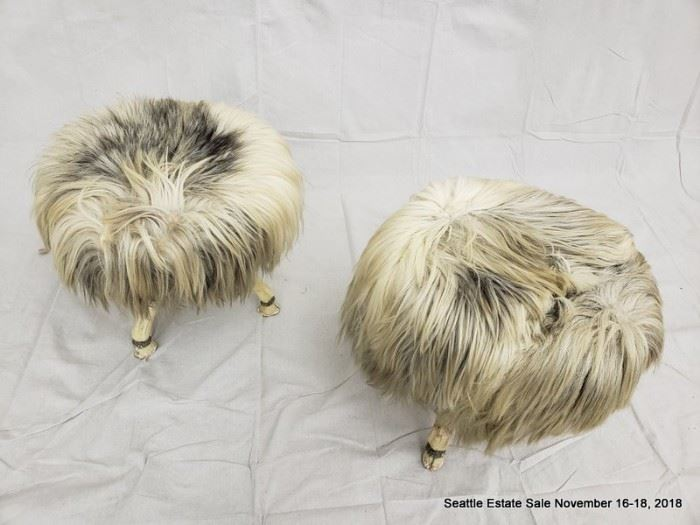 Long-haired round footstool with tri-footed animal-form legs and  hoofed feet.