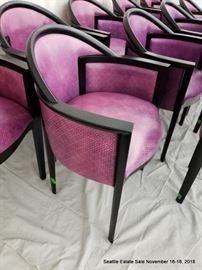 Set of 12 fuschia upholstered and ebonized frame dining chairs.