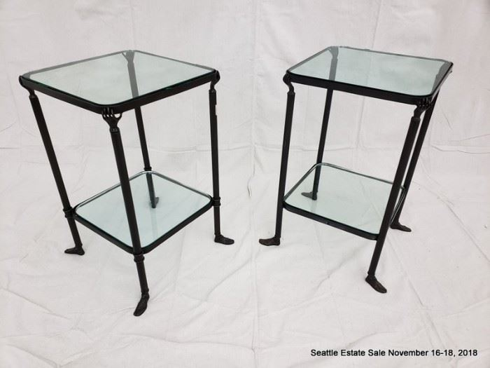 Patinated bronze and glass side table with hand and feet details.