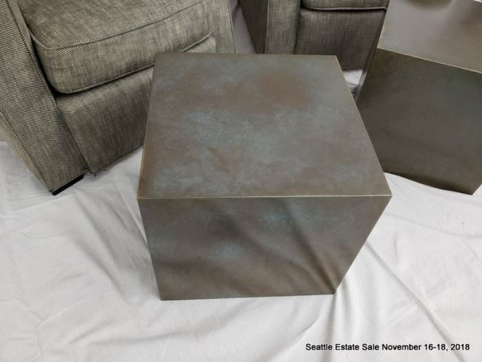 Upholstered club chair. Patinated bronze cube-form side table.