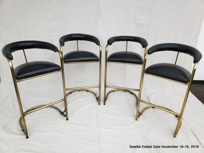 Set of four vintage tubular brass bar stools.