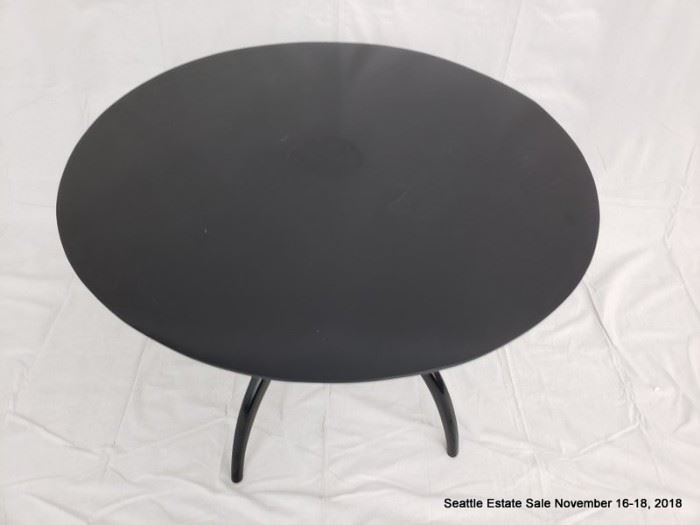 Round-top center table with ebonized finish