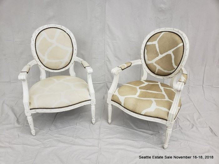 Open-arm chair with giraffe pattern upholstery