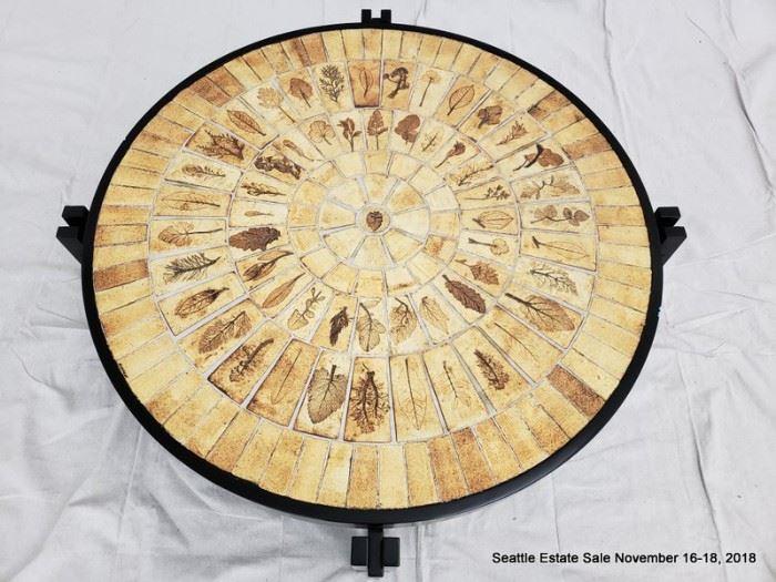 Pressed-leaf mosaic coffee table with ebonized base.