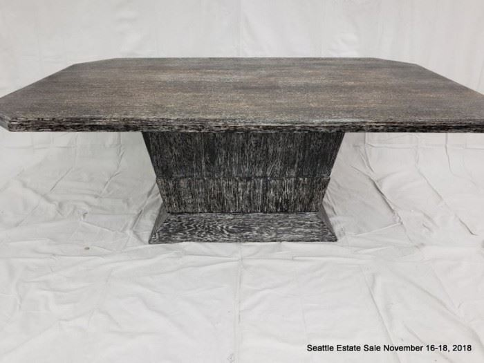 Rectangular cut-corner pedestal table with black and white striated cerused wood finish.