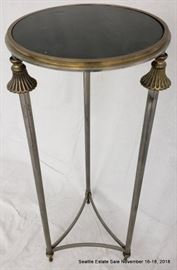Patinated bronze and glass pedestal table with fluted accents