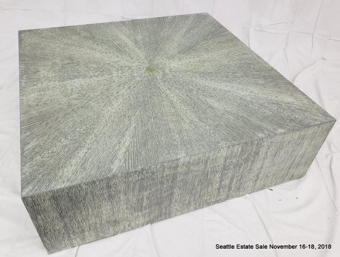 Square flush-side coffee table with green-tone striated cerused wood finish.